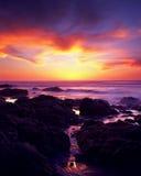 Solnedgång för strand för McClure ` s Royaltyfria Bilder