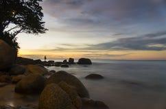 Solnedgång för strand för rev för Karen ` s royaltyfria foton