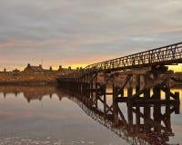 solnedgång för strandbrolossiemouth royaltyfri fotografi