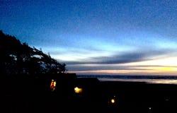 Solnedgång för strandhus Royaltyfria Foton
