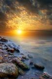 solnedgång för strandkanthav Arkivbilder
