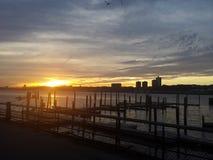 Solnedgång för västra sida Arkivbilder