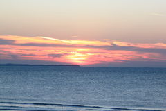 Solnedgång från ön av Ameland, Nederländerna Fotografering för Bildbyråer
