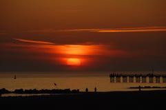Solnedgång från Brighton Beach, New York City arkivbild