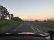 Solnedgång från ett chaufförperspektiv Arkivfoton