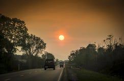 Solnedgång från huvudvägen Royaltyfria Foton