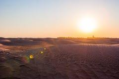 Solnedgång i öknen Arkivfoto