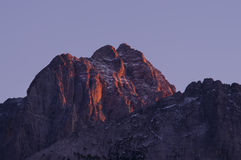 Solnedgång i Alps Royaltyfri Foto