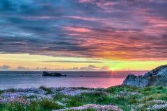 Solnedgång i Brittany, Frankrike Arkivfoton
