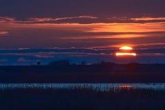Solnedgång i deltan Arkivfoto
