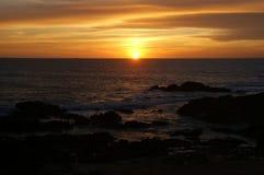 Solnedgång i den Leca da Palmeira stranden Fotografering för Bildbyråer