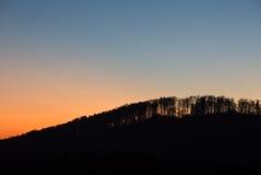 Solnedgång i den svarta skogen, Tyskland Royaltyfria Bilder
