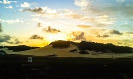 Solnedgång i dynerna royaltyfria bilder