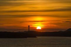 Solnedgång i fjordsna Arkivfoton