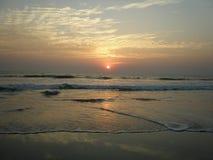 Solnedgång i Goa fotografering för bildbyråer