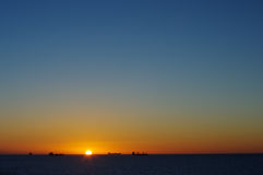 Solnedgång i havet Arkivfoton