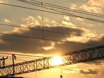 Solnedgång i järnvägsstationen Fotografering för Bildbyråer