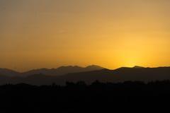 Solnedgång i kartbokberg Fotografering för Bildbyråer