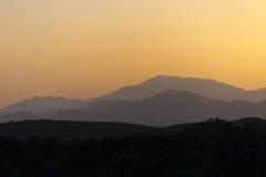 Solnedgång i kartbokberg Arkivfoton