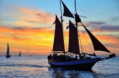 Solnedgång i Key West på marknadsfyrkanten Arkivfoto