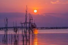 Solnedgång i laken Arkivfoto
