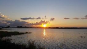 Solnedgång i laken Royaltyfri Foto