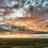 Solnedgång i landet Arkivbilder