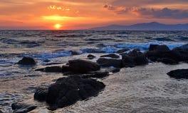 Solnedgång i Mykonos Arkivfoto