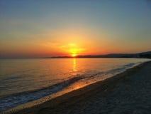 Solnedgång i Nikiti, Grekland Arkivfoto