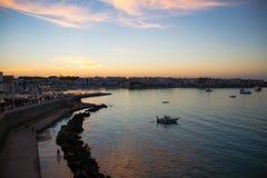 Solnedgång i Otranto Arkivfoto