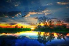 Solnedgång i pöl Royaltyfri Foto