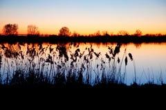 Solnedgång i pianuraen Padana Arkivfoton