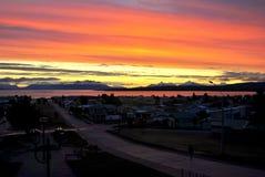 Solnedgång i Puerto Natales Arkivfoto