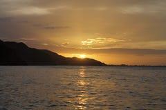 Solnedgång i Rio Caribe, Venezuela royaltyfria foton