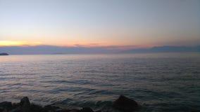 Solnedgång i Sidari Arkivfoto