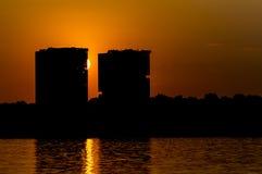 Solnedgång i stad Fotografering för Bildbyråer