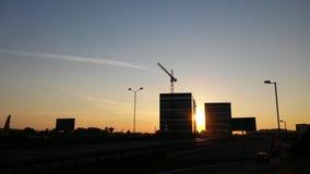 Solnedgång i staden Arkivbilder