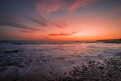 Solnedgång i stranden royaltyfri foto