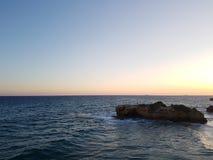 Solnedgång i stranden Royaltyfria Foton