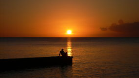 Solnedgång i Kuba. Arkivfoton