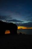 Solnedgång i SUNAYAMA-strand Royaltyfria Bilder