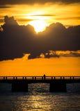Solnedgång med en fiskare Royaltyfri Foto