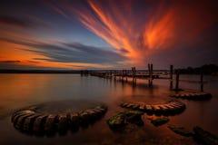 Solnedgång med fiskebåtar på sjön Royaltyfri Fotografi