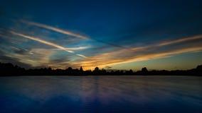 Solnedgång med fiskebåtar på sjön Fotografering för Bildbyråer