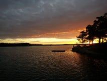 Solnedgång med silhouetten Arkivbilder