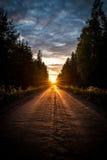 solnedgång in mot Arkivfoton