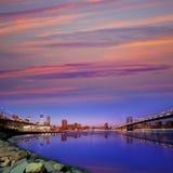 Solnedgång NY för broar för Brooklyn bro och Manhattan Fotografering för Bildbyråer