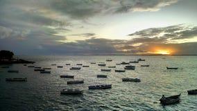 Solnedgång och fartyg Arkivbilder