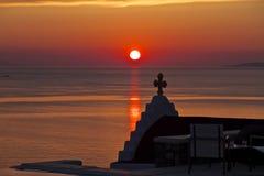 Solnedgång och kapell Mykonos, Grekland Fotografering för Bildbyråer