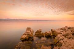 Solnedgång och moln fotografering för bildbyråer